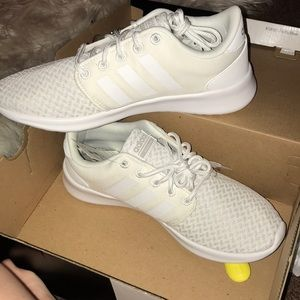 White Addias athletic tennis shoes